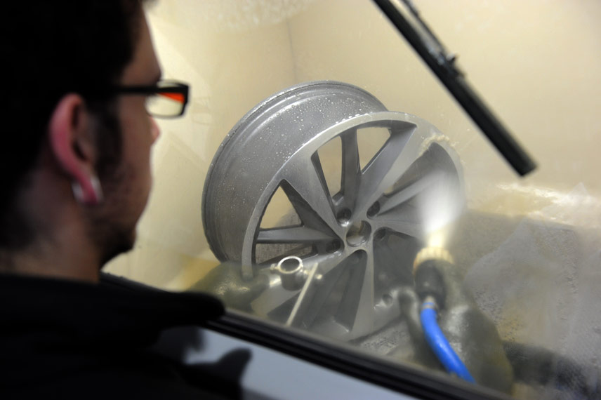 image of paint removal from alloy wheel